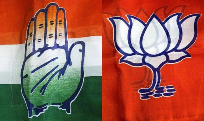 Congress and BJP symbols. Photo Courtesy: IANS