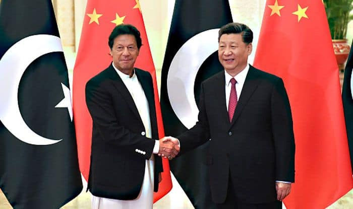 Pakistan PM Imran Khan with Chinese President Xi Jinping. Photo Courtesy: Getty Images