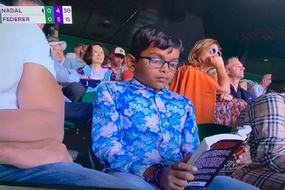 Wimbledon 2019 Roger Federer Rafael Nadal Federer Vs Nadal Federer Vs Nadal Wimbledon Young Boy Reads Book During Federer Vs Nadal Young Boy Wimbledon 2019 Boy Reads Book During Fedal Clash Tennis