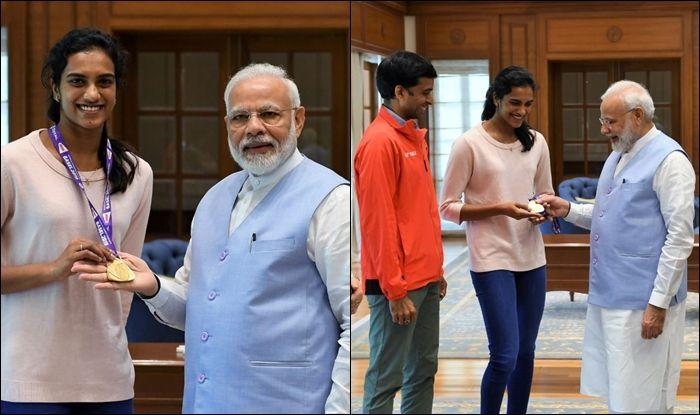 PM Narendra Modi, Rajyavardhan Singh Rathore, PV Sindhu, PV Sindhu returns home, PV Sindhu meets PM Narendra Modi, BWF, World Badminton Championships, PV Sindhu beat Nozomi Okuhara, PV Sindhu rankings, PV Sindhu titles, Badminton News