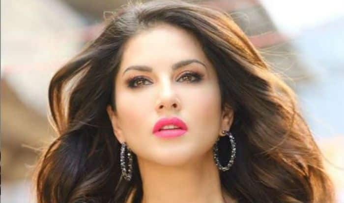 Sunny Leone Flaunts Figure in See-Through Black Dress With Hot Pink Lips