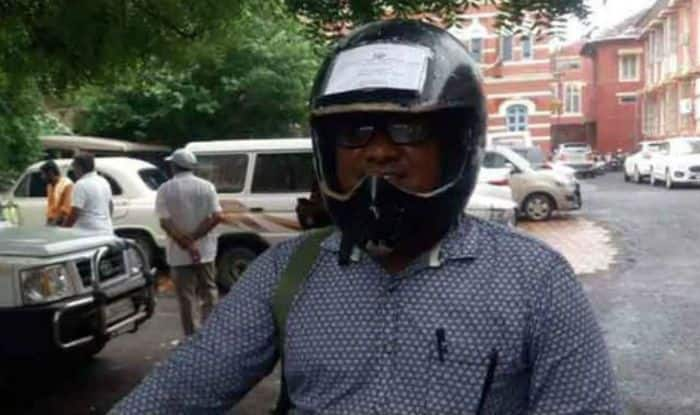 Vadodra Man Pastes All Bike Documents on His Helmet to Avoid Getting Challaned