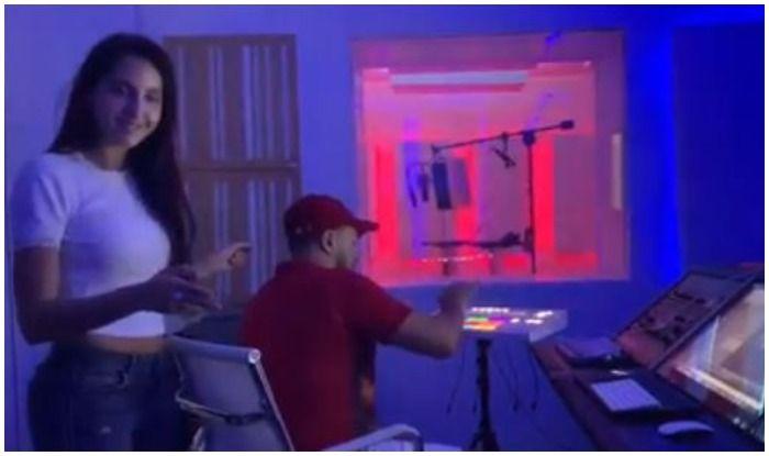Nora Fatehi breakdancing in a recording studio