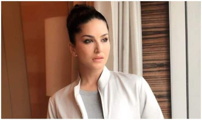 Sunny Leone Nails Her Casual Look in White Bomber Jacket And Blue Denims