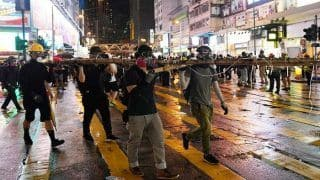 Trapped Hong Kong Protesters Slither Down Ropes, Whisk Away in Waiting Motorbikes: Report