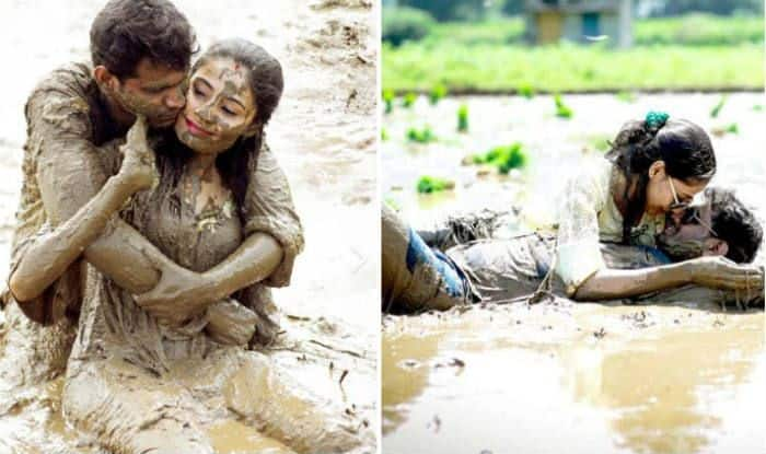 South Indian couple poses in muddy field