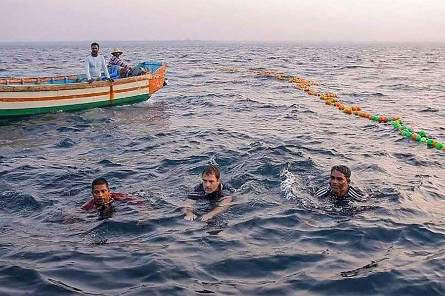 Rahul Gandhi swims with fishermen in Kollam.