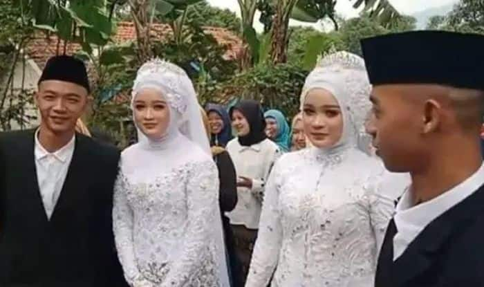 Identical twin brothers marry