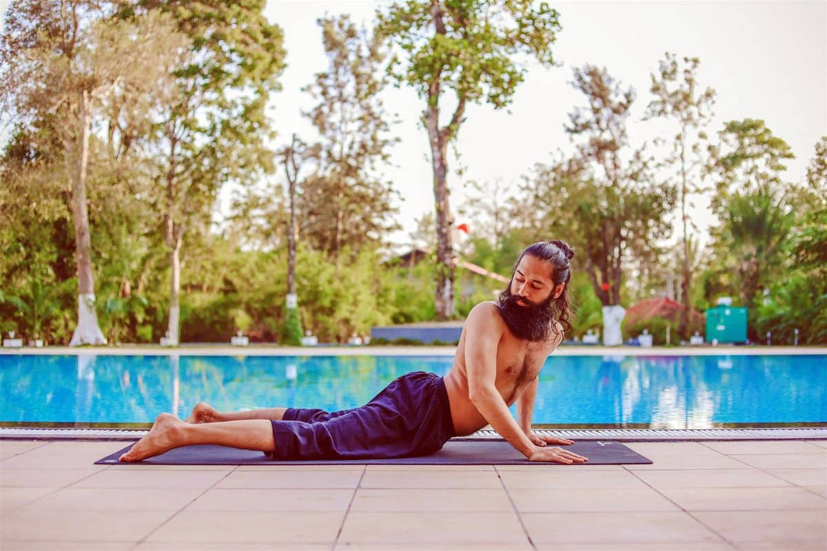 Twisted Cobra Pose (Triyaka Bhujangasana)