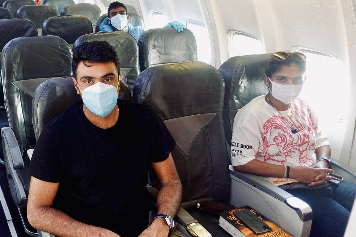 Indian Team Reach Mumbai | PHOTOS - R. Ashwin, Mayank Agarwal, Mithali Raj & Others Board Charter Flight For Mumbai | PICS | WTC Final | UK Tour