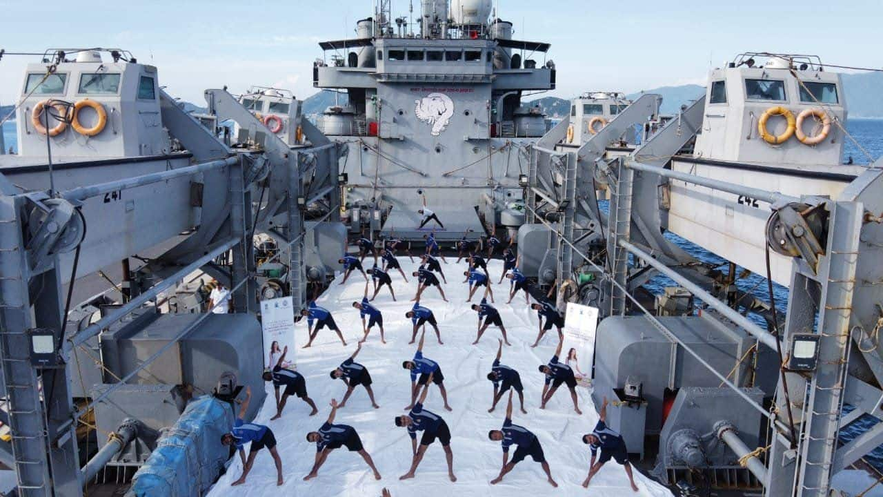 Indian Navy personnel, onboard INS Airavat and deployed at Cam Ranh Bay in Vietnam, perform Yoga