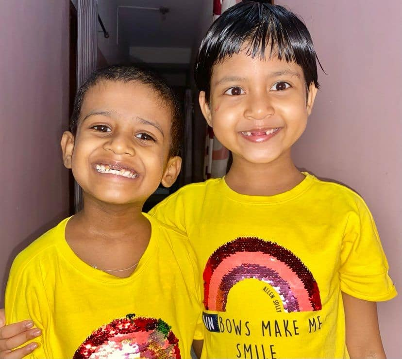 Six-year-old Rawza(R) and her Five-year-old brother Aryan(L) pose for a picture. (India.com photo)